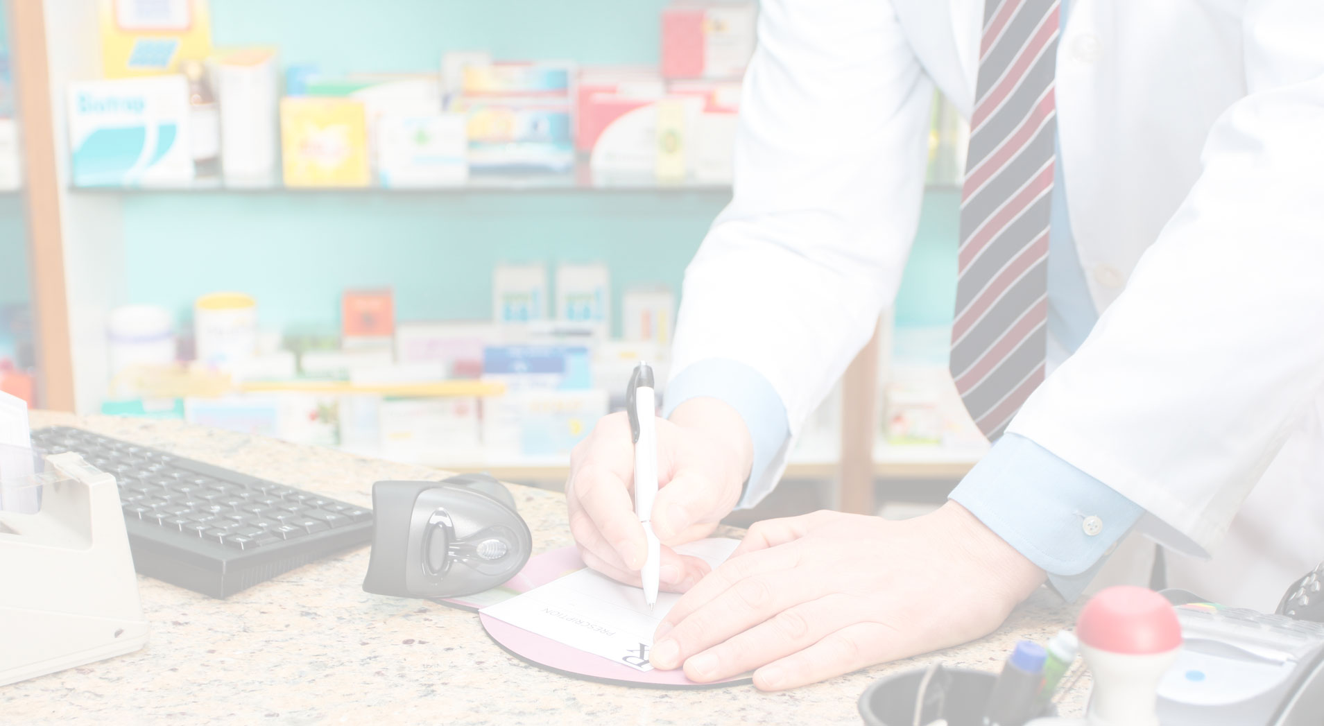 Specialty pharmacist writing prescription